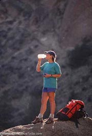 A woman mountain biking; Actual size=180 pixels wide